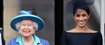 Queen Elizabeth II and Duchess Meghan on the balcony of Buckingham Palace on the centenary of the RAF on July 10, 2018.