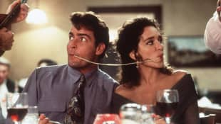 """Topper Harley"" (Charlie Sheen) & ""Ramada"" (Valeria Golino) in ""Hot Shot"""