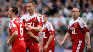 Michael Schumacher und Lukas Podolski