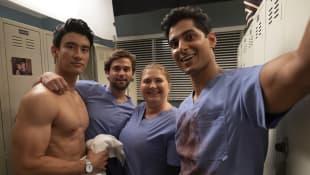 Alex Landi, Jake Borelli, Jaicy Elliot and Rushi Kota on the set of Grey's Anatomy in 2019.