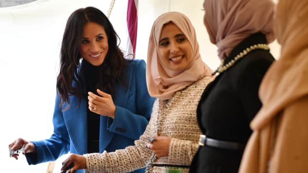 Duchess Meghan helps prepare food at charity cookbook launch for women affected by the Grenfell Tower fire in 2017