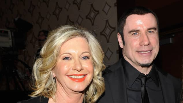 John Travolta supports Olivia Newton-John's fight against cancer