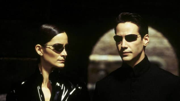 "Carrie-Anne Moss (""Trinity"") and Keanu Reeves as ""Neo"" in the 1999 worldwide hit The Matrix."