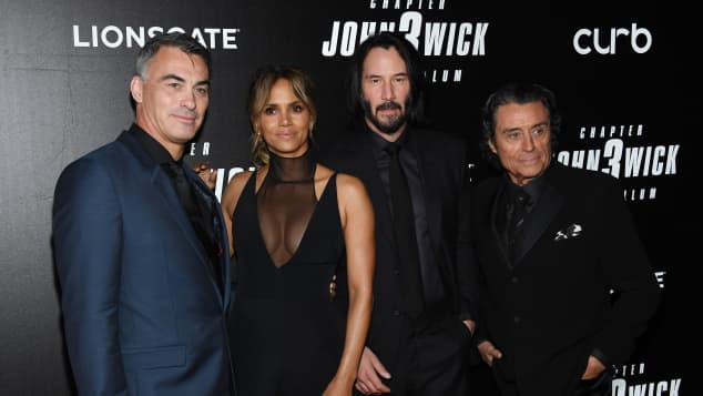 Director Chad Stahelski with the stars of John Wick: Halle Berry, Keanu Reeves and Ian McShane