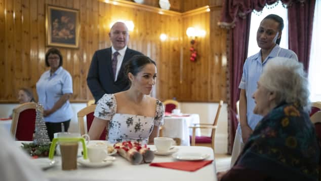 Duchess Meghan speaks to actress Josephine Gordon at Brinsworth House