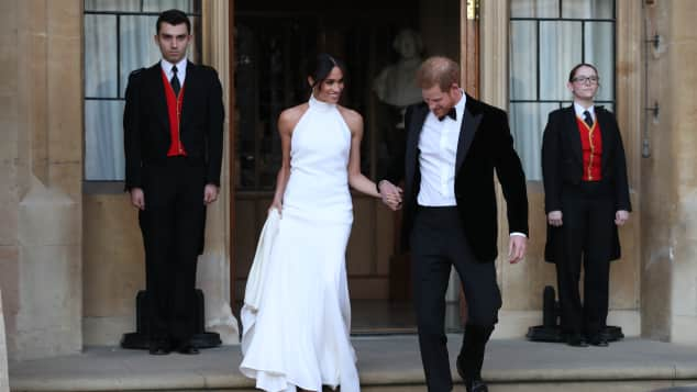 Meghan and Harry leave Windsor Castle after their wedding to attend an evening reception at Frogmore House