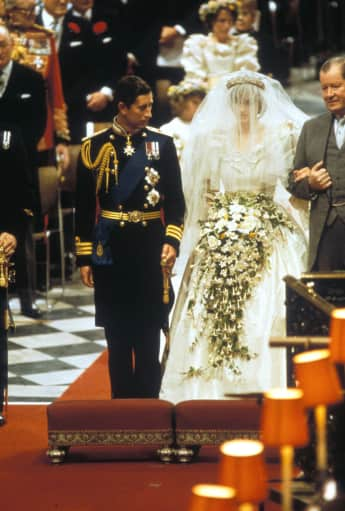 Lady Diana and Prince Charles walking down the aisle