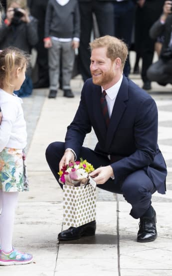 The Duke of Sussex greets a little fan after the Mayor's annnual Curry Lunch at the Guildhall.