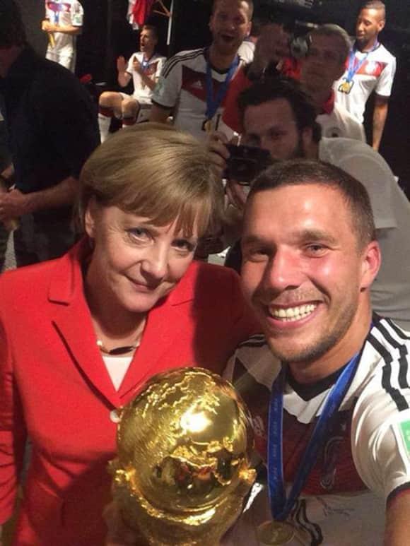 Angela Merkel und Lukas Podolski Weltmeister 2014