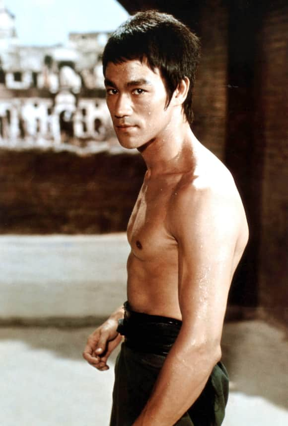 Bruce Lee showing off his amazing body