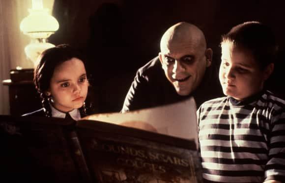 """Christina Ricci, Christopher Lloyd and Jimmy Workman in """"The Addams Family"""""""