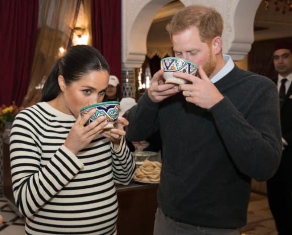 Harry and Meghan trying some Moroccan dishes