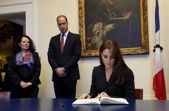 Prince William and Duchess Catherine signing the book of condolence after the Paris attacks