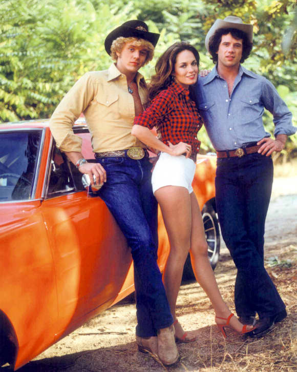 "John Schneider, Catherine Bach and Tom Wopat in ""The Dukes Of Hazzard"""