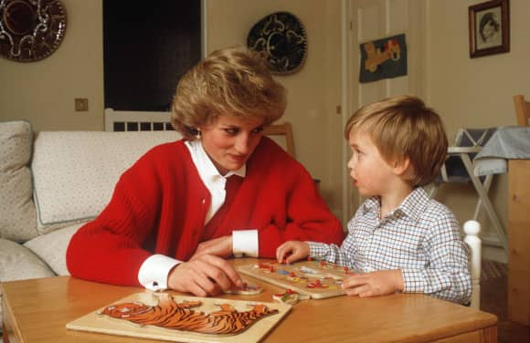 Princess Diana and Prince William doing a puzzle