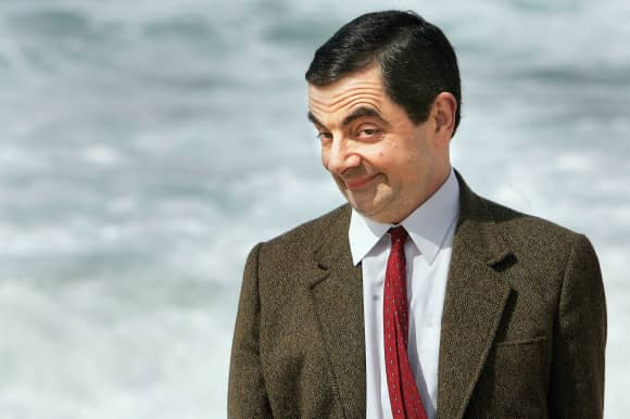 "Rowan Atkinson as ""Mr. Bean"" at the beach"