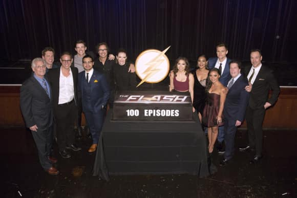The Cast of The Flash celebrating their 100th episode