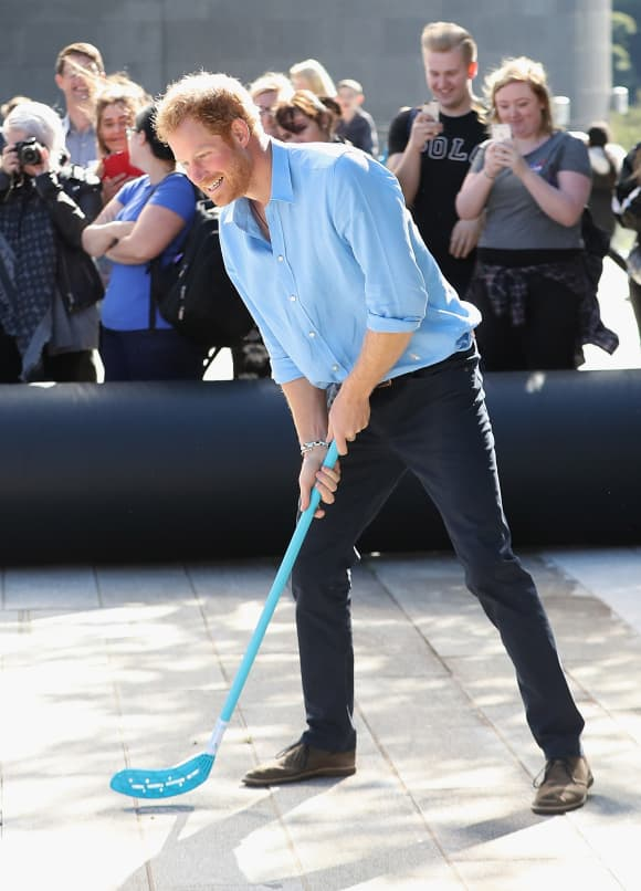 Prince Harry playing street hockey in Aberdeen