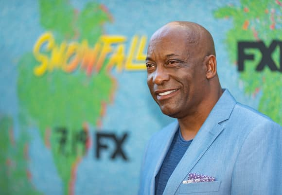 John Singleton, director of 2 Fast, 2 Furious arrives at the premiere of FX's Season 2 of Snowfall.