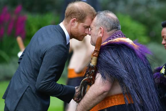 Prince Harry receives a 'hongi', or traditional Maori greeting, from an elder during an official welcoming ceremony at Government House in Wellington